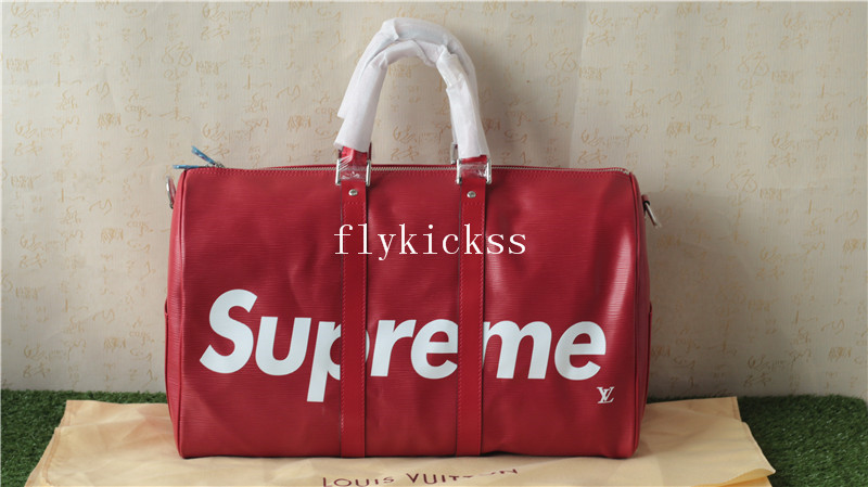 Supreme LVS Traveling Red Duffle Bag